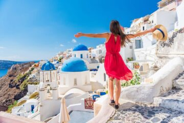 girl poses opening her arms on the top of roof