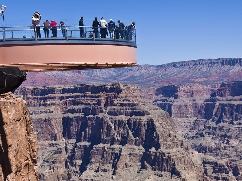 people standing on Grand Canyon Skywalk