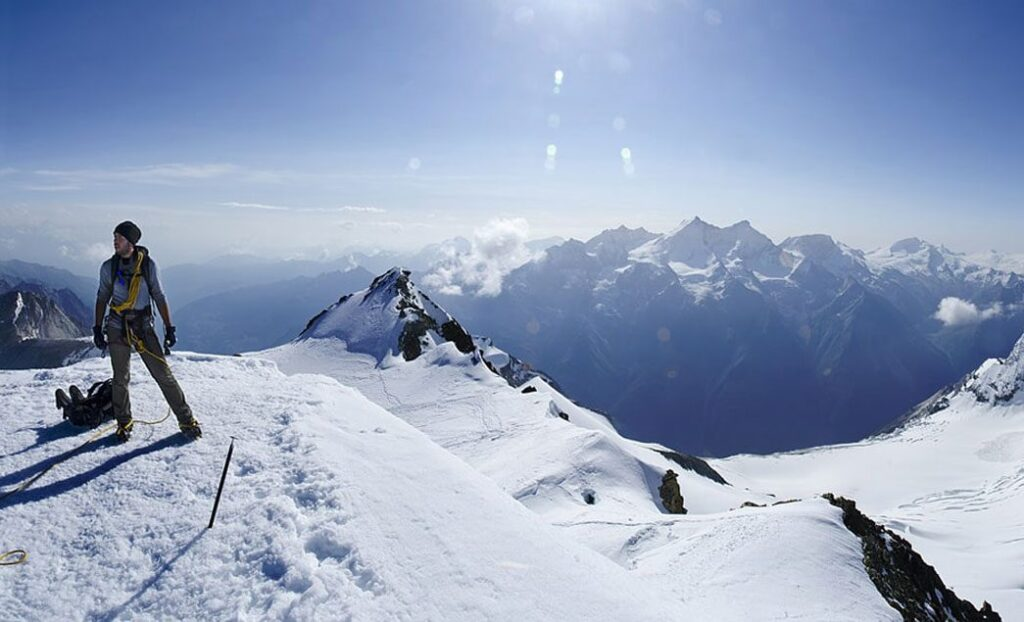Alps mountain picture with a man standing on top