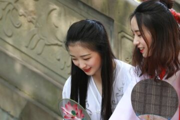 two Chinese girls smiling