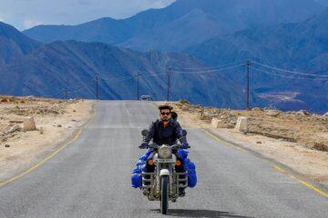 a biker rider on ladakh road