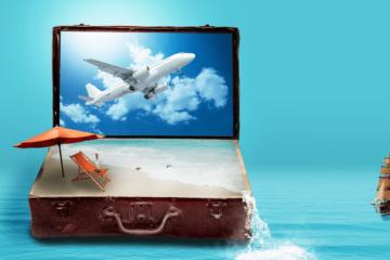 laptop on travel bag in the ocean