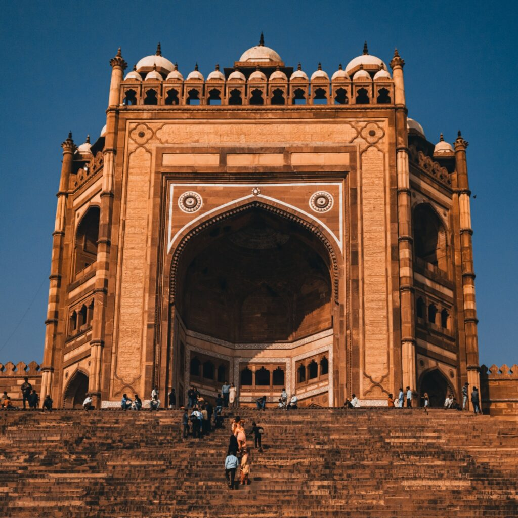 Ancient architectural design in lucknow india with public standing outside