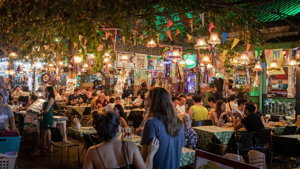 A restaurant full of people enjoying their food