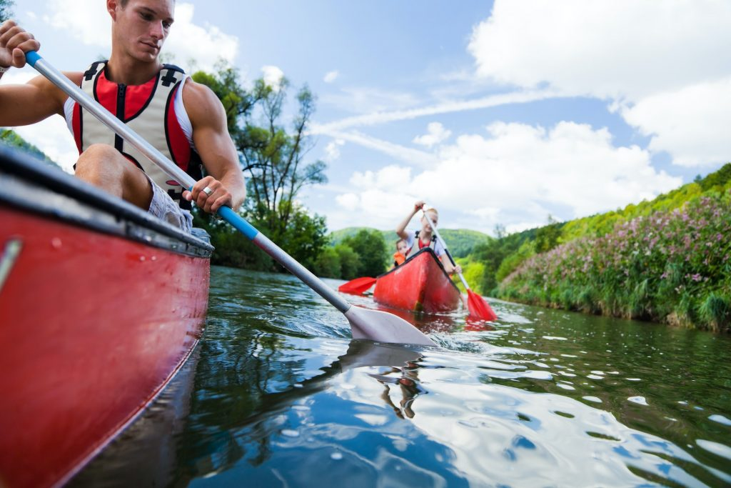Mand and woman paddling their paddles and they enjoy kayaking