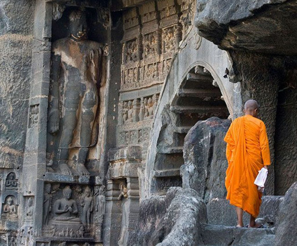 A monk standing outside the holy cave