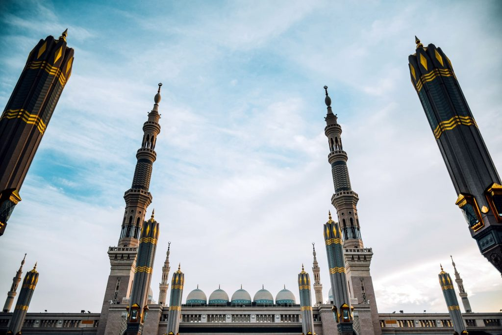 Tall dome pillars or creamy white and black with real golds on them