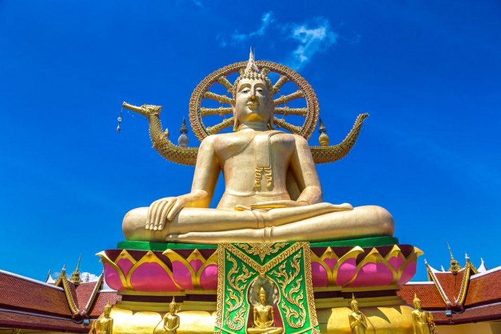 A hindu god temple under blue sky during daylight