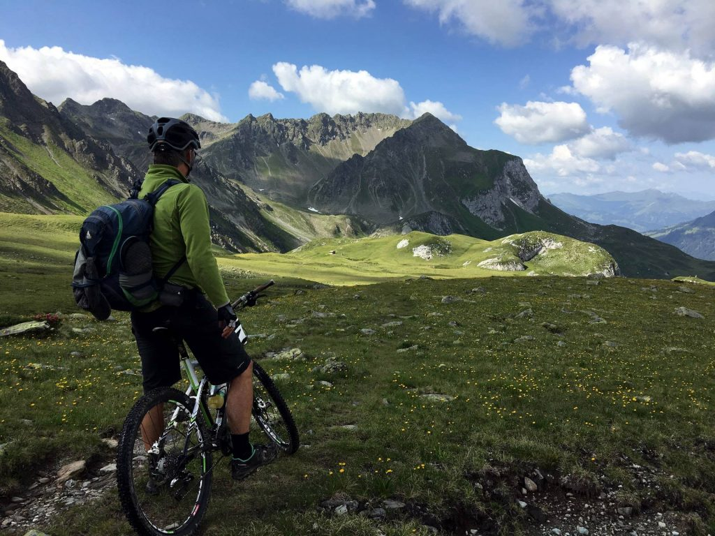 man riding bicycle on top of mountain photo