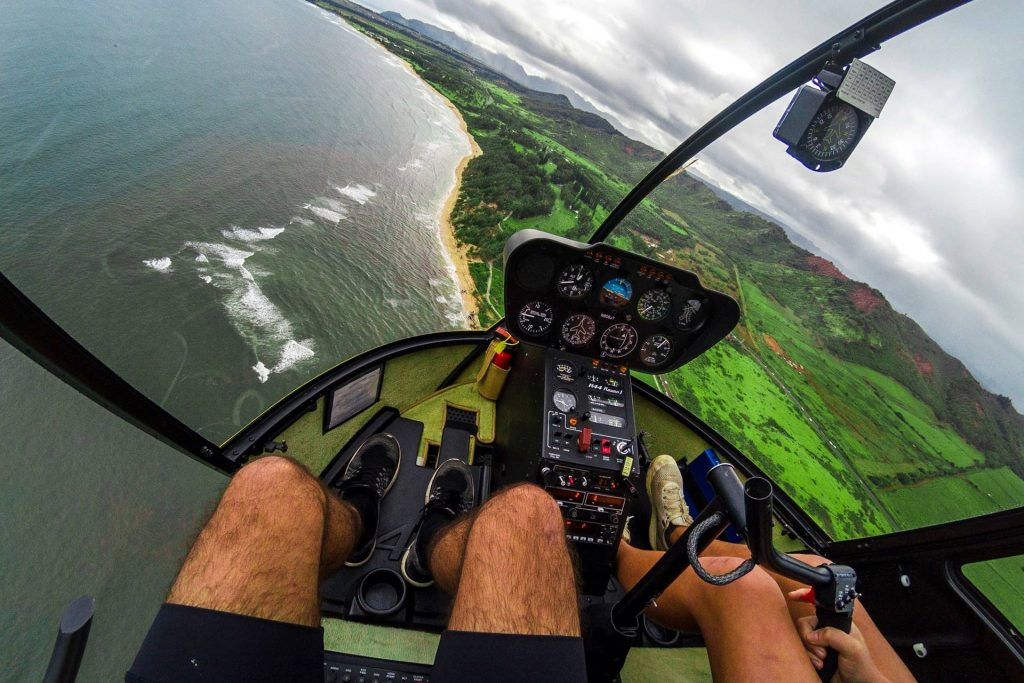 people riding helicopter at aerial vehicle photo
