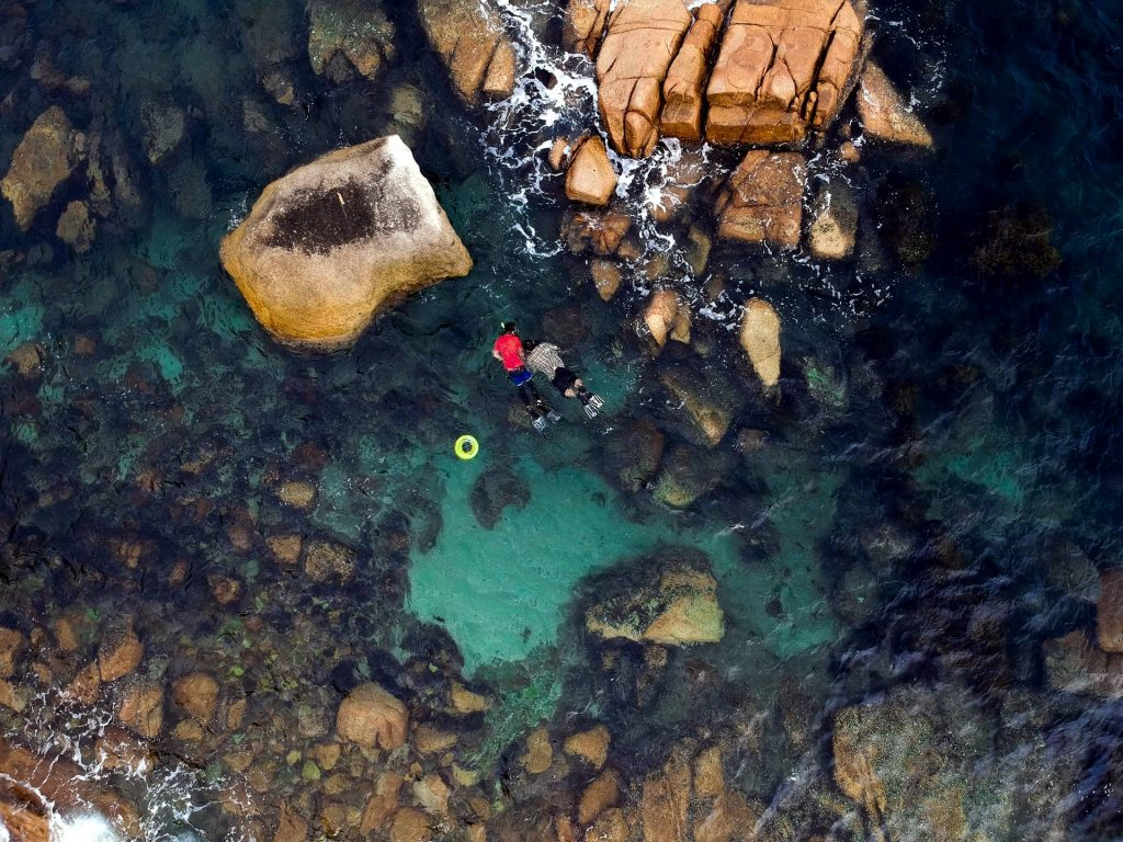 aerial photography of rock formations on body of water during daytime photo