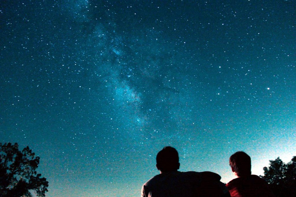 silhouette photo of two person watching stars photo