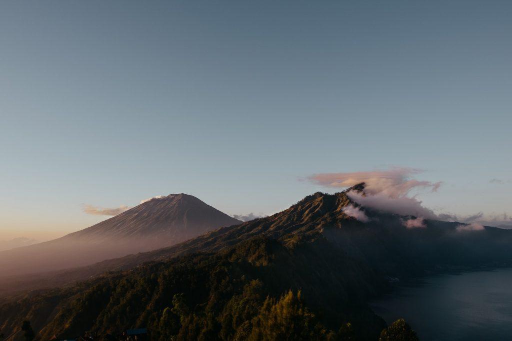 Areal shot of volcano beside ocean