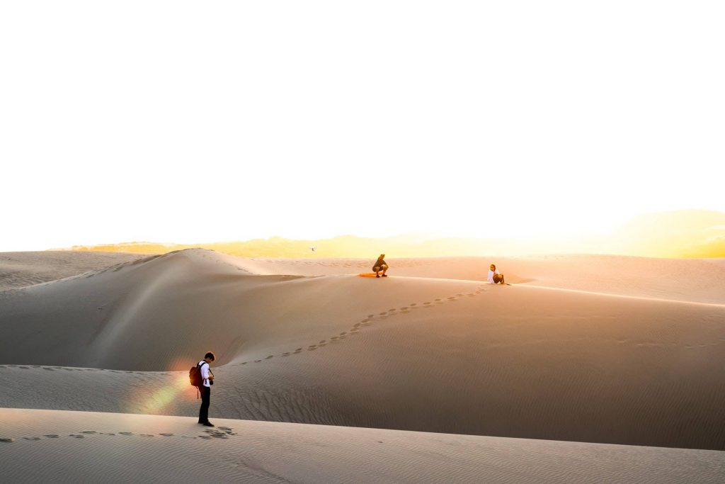 3 people enjoying the desert island