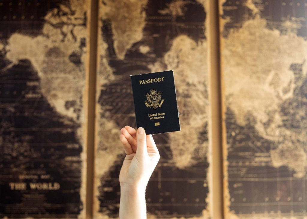 Passports of USA behind world map
