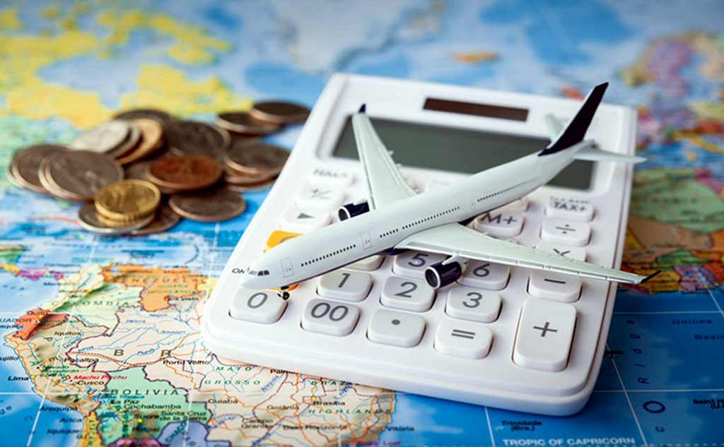 Toy plane on top of a calculator and world map