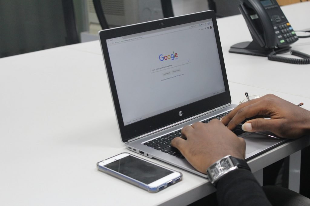 Man with his laptop doing research on Google