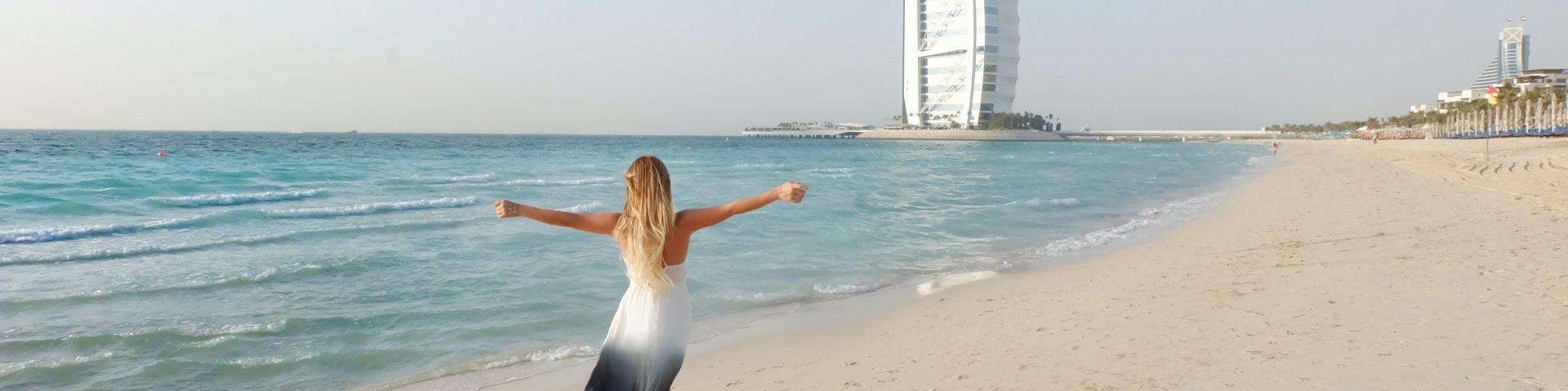 girl posing infront of burj al arab in dubai